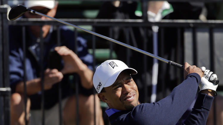 Tiger Woods tees off the first hole during a practice round for the Match Play Championship golf tournament, Tuesday, Feb. 19, 2013, in Marana, Ariz. (AP Photo/Julie Jacobson)