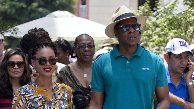 U.S. singer Beyonce and her husband, rapper Jay-Z, hold hands as they tour Old Havana, Cuba, Thursday, April 4, 2013. R&B's power couple is in Havana on their fifth wedding anniversary. (AP Photo/Ramon Espinosa)