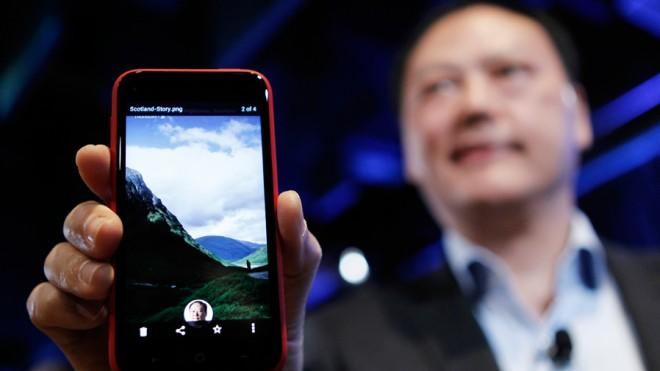 """HTC CEO Peter Chou holds the new Android program Facebook Home, which, according to some, is """"off to a rough start."""""""