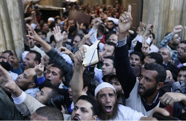 Muslim Brotherhood and Egyptian President Morsi supporters chant slogans during a funeral of three victims who were killed during Wednesday's clashes outside Al Azhar mosque, the highest Islamic Sunni