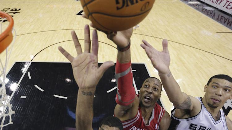 Harden, Howard help Rockets roll past Spurs