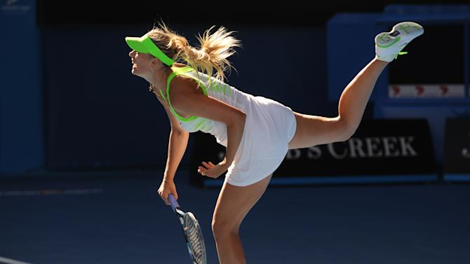 Maria Sharapova of Russia serves during her semi-final women's singles match against Petra Kvitova of Czech Republic on the eleventh day of the Australian Open tennis tournament in Melbourne on January 26, 2012.   Sharapova won 6-2, 3-6, 6-4. .    IMAGE STRICTLY RESTRICTED TO EDITORIAL USE STRICTLY NO COMMERCIAL USE   AFP PHOTO/William WEST (Photo credit should read WILLIAM WEST/AFP/Getty Images)