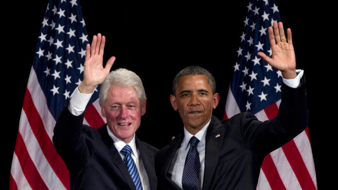 Former President Bill Clinton and President Barack Obama wave to the crowd during a campaign event at the Waldorf Astoria, Monday, June 4, 2012, in New York. (AP Photo/Carolyn Kaster)