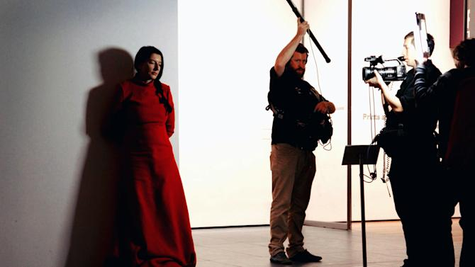 "In this undated photo released by Rio Film Festival, performance artist Marina Abramovic works during the making of the documentary film ""The Artist is Present"" in an unknown location. The Belgrade-born artist is best known for her piece ""The Artist Is Present,"" which in 2010 saw her sit silent and motionless for 736.5 hours opposite a parade of strangers at New York's Museum of Modern Art. The film is playing at the 2012 Rio de Janeiro International Film Festival. (AP Photo/Rio Film Festival)"