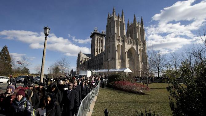 People leave the Washington National Cathedral in Washington, Tuesday, Jan. 22, 2013, after the National Prayer Service, attended by President Barack Obama and Vice President Joe Biden, and their spouses. The 106-year-old Episcopal church has long hosted presidential inaugural services., this one following Monday's 57th Presidential Inauguration.    (AP Photo/Manuel Balce Ceneta)