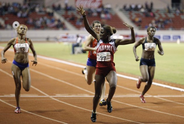 Panama's Ruth Hunt celebrates as she crosses the finish line along with Costa Rica's Glenda Davis, Diana Garita and Honduras' Jeimmy Bernardez in the women's 100m final at the Central American Games i