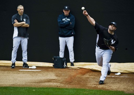 New York Yankees' Girardi and Rothschild watch Chamberlain throw in the bullpen during an early morning workout at the team's spring training complex in Tampa
