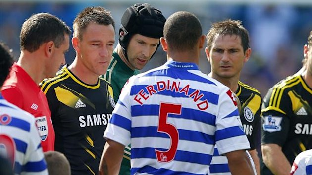 Anton Ferdinand of Queens Park Rangers walks past John Terry (2nd L) of Chelsea without shaking his hand before the start of their English Premier League soccer match at Loftus Road in London, September 15, 2012 (Reuters)