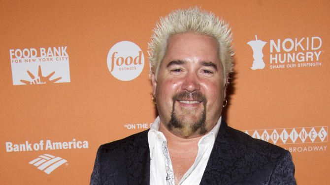 """Guy Fieri attends """"On The Chopping Block: A Roast of Anthony Bourdain"""" on Thursday, Oct. 11, 2012 in New York. (Photo by Charles Sykes/Invision/AP Images)"""