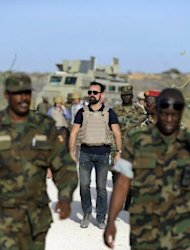 Russia's Evgeny Lebedev (C), 31, seen here amongst African Union troops in Somalia's war-shattered capital Mogadishu. Among the journalists covering the conflict in Somalia, this one stands out: under his bulletproof vest, Lebedev is also the son of a Russian oligarch Alexander Lebedev and is also a British press baron