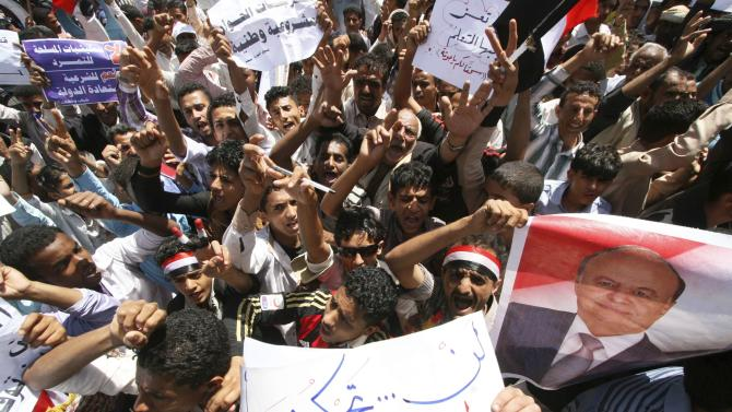 Anti-Houthi protesters shout slogans during demonstration to show support to Yemen's President Abd-Rabbu Mansour Hadi in the southwestern city of Taiz
