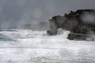 "This file photo shows wild surf breaking on the cliffs of Bronte Beach as a storm continue to lash the coast of Sydney, in 2011. An Australian study of ocean salinity over the past 50 years has revealed a ""fingerprint"" showing that climate change has accelerated the rainfall cycle, according to a researcher"