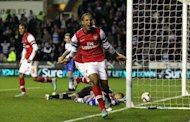 Theo Walcott, pictured, can develop into a top-class striker according to Arsene Wenger