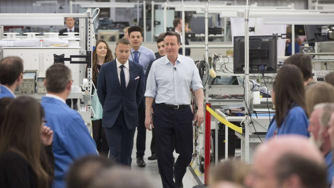 Britain's Prime Minister David Cameron arrives to give a speech during an election campaign visit to a business in London