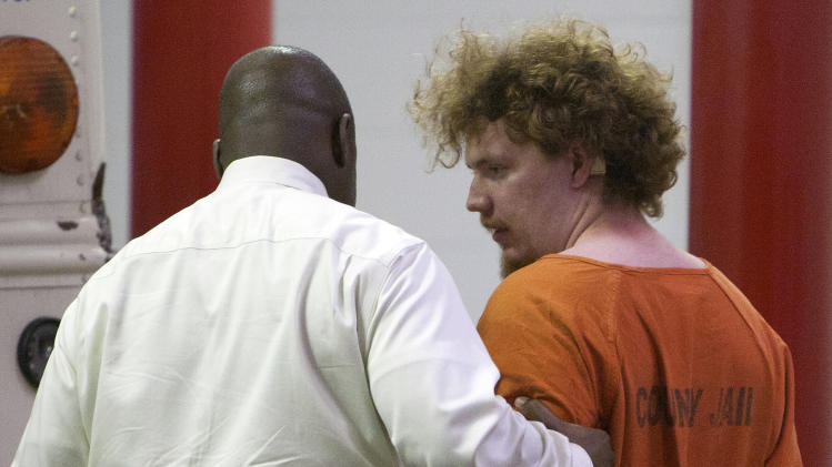 Dylan Quick, who is a suspect in the multiple stabbings on the Lone Star Cy-Fair Campus, right, is escorted by Harris County Sherrif's Office investigators after being questioned, Tuesday, April 9, 2013, in Houston.  Quick, a student at the school, allegedly went on a building-to-building stabbing attack at the Texas community college Tuesday, wounding at least 14 people — many in the face and neck — before being subdued and arrested, authorities and witnesses said. (AP Photo/Houston Chronicle, Cody Duty)
