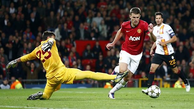 Manchester United's Michael Carrick (C) goes past Galatasaray's Fernando Muslera (L) to score during their Champions League Group H match at Old Trafford (Reuters)