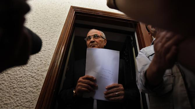 "Egyptian presidential candidate Ahmed Shafiq is seen before a press conference at his office in Cairo, Egypt, Saturday, May 26, 2012. Egyptian presidential candidate Ahmed Shafiq paid tribute Saturday to the ""glorious revolution"" that toppled Hosni Mubarak, a dramatic turn-around for the former regime official who fought his way into the runoff elections by appealing to public disenchantment with last year's uprising. (AP Photo/Khalil Hamra)"