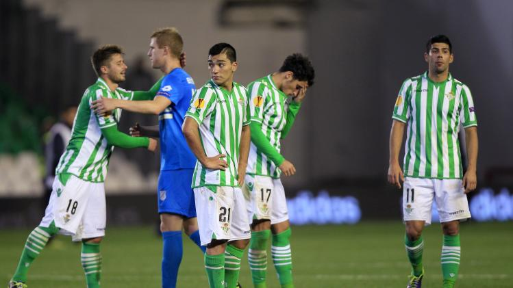 Real Betis' Markus Steinhofer congratulates Rijeka's Mateo Bertosa after the end of their Europa League soccer match in Seville