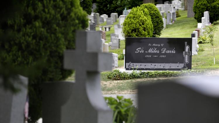 "The gravestone of jazz great Miles Davis sits in the ""Jazz Corner"" at Woodlawn Cemetery in the Bronx section of New York, Wednesday, July 9, 2014. Earlier in the year, the cemetery opened additional burial plots behind Davis' grave in order to accommodate any fans who wish to be buried near him. Most of the plots have already been sold. (AP Photo/Seth Wenig)"
