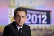 France&#39;s incumbent president and ruling party candidate for the 2012 presidential election Nicolas Sarkozy is seen before an evening news broadcast