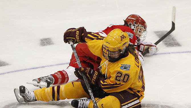 Minnesota forward Meghan Lorence (20) and Boston University forward Rebecca Russo fight for the puck in the women's Frozen Four NCAA Championship college hockey game, Sunday, March 24, 2013, in Minneapolis. (AP Photo/Stacy Bengs)