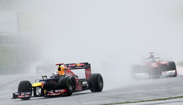 Red Bull-Renault driver Sebastian Vettel of Germany approaches the bend during the Formula One's Malaysian Grand Prix at the Sepang International Circuit in Sepang on March 25, 2012  AFP PHOTO / ROSLA