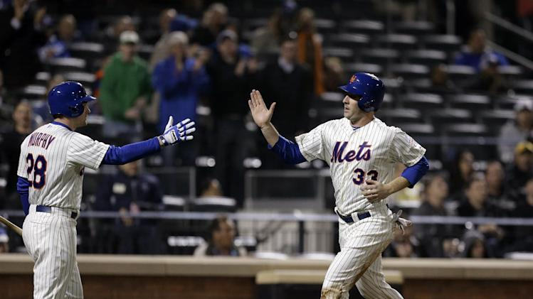 New York Mets on-deck batter Daniel Murphy greets Matt Harvey as Harvey scores on Ruben Tejada's fifth-inning, RBI single in a baseball game against the Los Angeles Dodgers at Citi Field in New York, Wednesday, April 24, 2013. (AP Photo/Kathy Willens)
