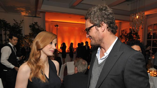 Jessica Chastain, left, and Jason Clarke attend The Hollywood Reporter Nominees' Night at Spago on Monday, Feb. 4, 2013, in Beverly Hills, Calif. (Photo by John Shearer/Invision for The Hollywood Reporter/AP Images)