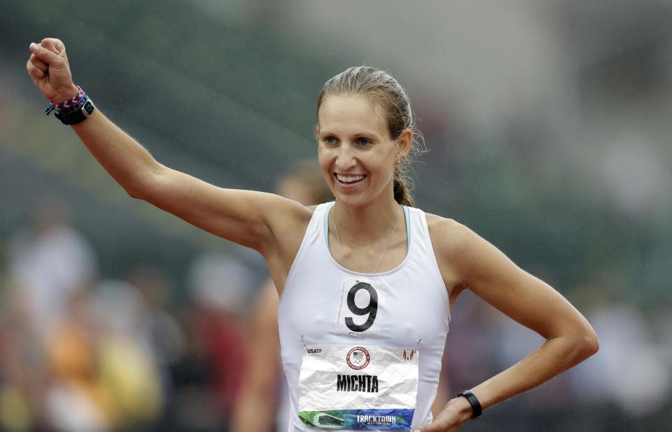 Maria Michta celebrates after winning the women's 20-kilometer race walk at the U.S. Olympic Track and Field Trials, Sunday, July 1, 2012, in Eugene, Ore. (AP Photo/Marcio Jose Sanchez)