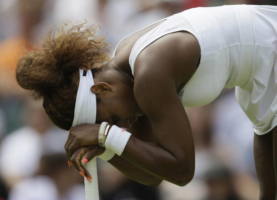 Serena Williams of the United States reacts during her Women's second round singles match against Caroline Garcia of France at the All England Lawn Tennis Championships in Wimbledon, London, Thursday, June 27, 2013. (AP Photo/Alastair Grant)