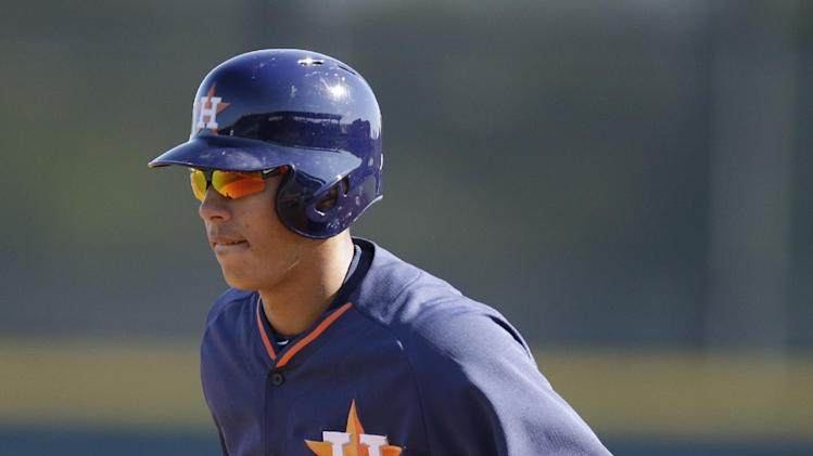 Houston Astros shortstop Carlos Correa leads off first during drills before a spring training baseball game against the Toronto Blue Jays in Kissimmee, Fla., Sunday, March 9, 2014. (AP Photo/Carlos Osorio)