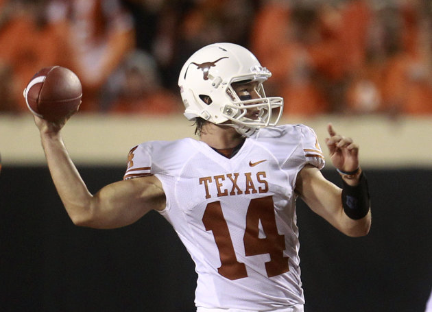 Texas quarterback David Ash passes against Oklahoma State in the second quarter of an NCAA college football game in Stillwater, Okla., Saturday, Sept. 29, 2012. (AP Photo/Sue Ogrocki)
