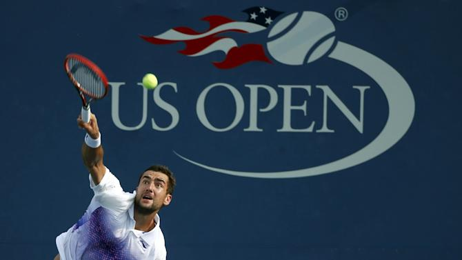 Cilic of Croatia serves to Pella of Argentina during their match at the U.S. Open Championships tennis tournament in New York