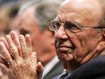 Murdoch heads to Britain as News of the World closes