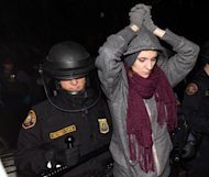 A protester is forcibly removed from Jamison Park in Portland, Ore., early Sunday, Oct. 30, 2011. A large group marched from the downtown Occupy Portland camp in an attempt to occupy the park when police moved in with riot gear and horses to make approximately 30 arrests. (AP Photo/Don Ryan)