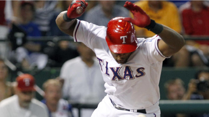 Texas Rangers' Adrian Beltre (29) is hit by a pitch from Tampa Bay Rays starting pitcher James Shields with the bases loaded during the fourth inning of Game 2 of baseball's American League division series playoffs, Saturday, Oct. 1, 2011, in Arlington, Texas. The Rangers' Elvis Andrus scored. (AP Photo/LM Otero)