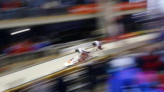 Latvia's Oskars Melbardis (L) and Daumants Dreiskens run at the start of their two-men bobsleigh test event at Sochi