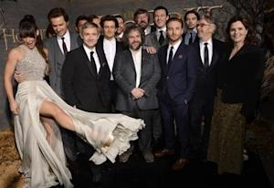 """Cast and crew members pose at the premiere of the film """"The Hobbit: The Desolation of Smaug"""" in Los Angeles"""