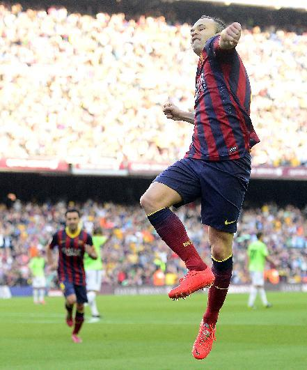 FC Barcelona's Andres Iniesta celebrates after scoring during a Spanish La Liga soccer match against Osasuna at the Camp Nou stadium in Barcelona, Spain, Sunday, March 16, 2014
