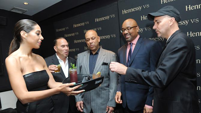 IMAGE DISTRIBUTED FOR HENNESSY V.S - Ralph Paniagua, left, Baseball Hall of Famer Orlando Cepeda, center, Rodney Williams, Senior Vice President, Hennessy USA, and Duane Rieder, right, Executive Director, Clemente Museum, enjoy the Hennessy V.S Latinos in Baseball event at the Parlor in New York, Thursday, June 27, 2013. (Photo by Diane Bondareff/Invision for Hennessy V.S/AP Images)