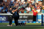 New Zealand&#39;s Martin Guptill hits a shot during their second Twenty20 international against England in Hamilton on February 12, 2013. Guptill (47) and Hamish Rutherford (40) provided a solid platform for skipper Brandon McCullum to blast away late in the innings in a display that included three sixes off a Stuart Broad over