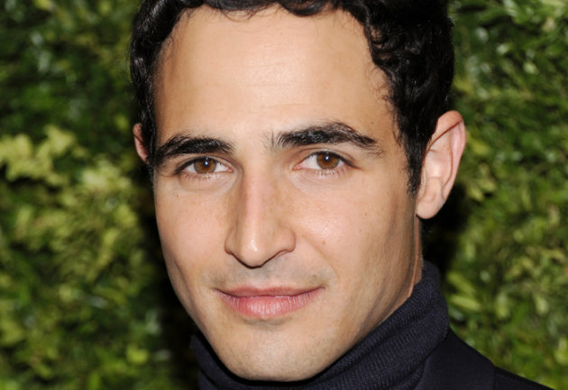 FILE - In this Nov. 14, 2011 file photo, designer Zac Posen attends the CFDA / Vogue Fashion Fund Awards in New York. Posen is the new featured judge for the new season of Project Runway, filling the chair that Michael Kors had sat in for the shows first 10 seasons. The new season starts Jan. 24, 2013. (AP Photo/Evan Agostini, File)