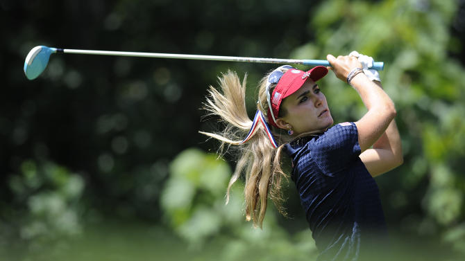 Lexi Thompson tees off the second hole during the third round of the International Crown golf tournament on Saturday, July 26, 2014, in Owings Mills, Md.(AP Photo/Gail Burton)