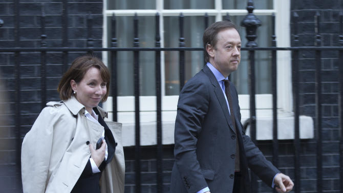 The editor of the London Evening Standard Sarah Sands, with editor of the London Mail On Sunday newspaper Geordie Greig leave Downing street after a meeting of fellow newspaper editors  and the British Prime Minister David Cameron following the release of the Leveson media inquiry in London,Tuesday, Dec. 4, 2012. Cameron has warned newspaper editors they must act quickly to set up an independent press regulator in the wake of a media ethics scandal. (AP Photo/Alastair Grant)