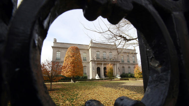 This Nov. 19, 2010 file photo shows the Elms mansion as seen through an opening in an iron fence, in Newport, R.I.  Newly discovered photographs, documents and family histories have inspired the creation of a tour about servants at The Elms, echoing themes of the British drama program,