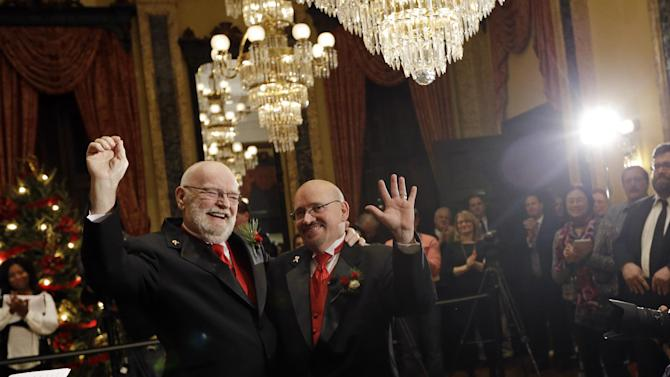 James Scales, left, and William Tasker react after participating in a wedding ceremony at City Hall in Baltimore, Tuesday, Jan. 1, 2013. Same-sex couples in Maryland are now legally permitted to marry under a new law that went into effect after midnight on Tuesday. Maryland is the first state south of the Mason-Dixon Line to approve same-sex marriage. (AP Photo/Patrick Semansky)
