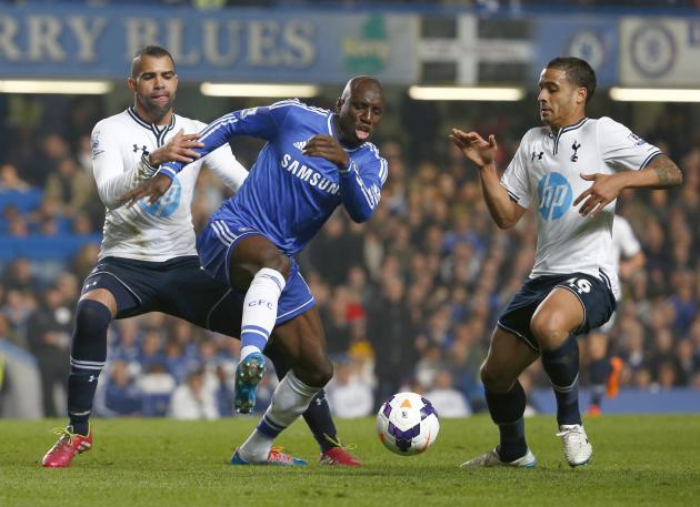 Chelsea's Ba is challenged by Tottenham Hotspur's Sandro and Naughton during their English Premier League soccer match at Stamford Bridge in London