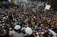 <p>Pakistani protesters listen to Maulana Fazl-Ur-Rahman, leader of the Jamiat Ulema-e-Pakistan political party, during a protest rally in Lahore against proposed changes to blasphemy laws in 2011. Pakistan's government has been heavily criticised in the West for refusing to reform the anti-blasphemy law, despite the assassinations of a leading politician and a Christian cabinet minister in 2011.</p>