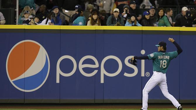 In this Friday, April 12, 2013, photo, Seattle Mariners starting pitcher Hisashi Iwakuma warms up next to a Pepsi advertisement before a baseball game against the Texas Rangers, in Seattle. PepsiCo Inc. reports quarterly financial results before the market opens on Wednesday, July 24,2013. (AP Photo/Ted S. Warren)