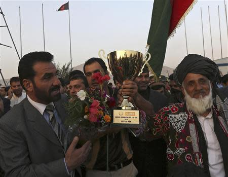 File photo of Afghan cricket team captain Mohammad Nabi Esa Khil holding the ACC Cup in Kabul